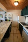 The galley kitchen is equipped with all full size appliances.