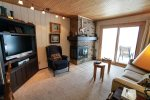 This one bedroom unit features a brick fireplace and flat screen TV.