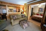 This beautifully remodeled unit has a cozy cabin feel .
