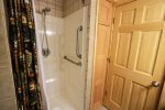 Walk-in shower is easily accessible for those with mobility issues