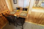 Built in seating for four at the end of the kitchen is great for dining and playing card games