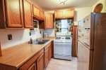 Kitchen equipped with full size appliances.