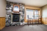 There is a decorative fireplace and eating area overlooking Lake Superior.