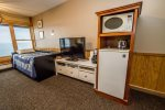 This suite features a TV with a DVD player, mini fridge, small microwave, and a small coffee pot.