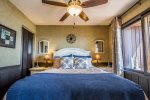 The bedroom features a queen sized bed.