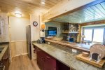 The galley style kitchen has a passway into the living room area.