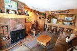 The cozy but open living space features the largest moose friend of all and a brick fireplace