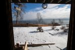 Wintery view of Lake Superior from the sliding glass door.  This unit is just steps away from the charcoal BBQ.
