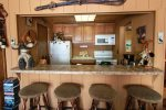 The kitchen opens into the living room so you can be cooking while you look out the sliding door at beautiful Lake Superior