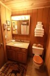 Newly remodeled bathroom includes large vanity and tub/shower combo