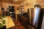 Stainless steel appliances and deep sink make this a cook`s dream kitchen