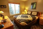 Enjoy the Northern Lights artwork in this beautifully decorated main level bedroom, as well as the Lake Superior views out the window.