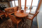 The dining room table provides a comfortable eating space and more great views of Lake Superior.