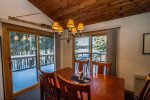 The sliding glass doors from the dining room lead out to the spacious lake-facing deck.