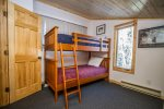 The second bedroom has a twin over twin bunk bed.