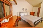 The bedroom features a king bed and great Lake Superior views when the divider is open and TV hidden away.