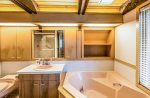 The attached master bathroom has a separate jetted tub and shower.