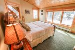 The second bedroom, located on the upper level, has a queen size bed and great Lake Superior views.