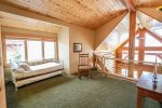 The sleeping loft has twin trundle beds and looks down over the living room.  You can also enjoy the large living room windows for natural light and Lake Superior views.