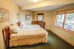 Located on the lower level, the third bedroom features two twin beds.