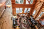 The view of the living room from the loft area above. You will love the high ceilings and wood beams.