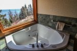Retreat room has a jetted double jacuzzi with a Lake view.