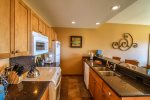 Well-equipped kitchen with granite counter tops for you to make delicious meals during your stay.