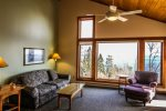 Seating for everyone in the bright, cheerful living room that offers Lake Superior views from the large windows.