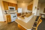 The fully equipped kitchen has standard appliances and counter room for two additional seats.