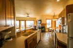 Open to the living room area, this kitchen has plenty of counter space for you to prepare meals during your stay.
