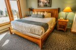 Master bedroom features a king bed and a view of Lake Superior.