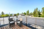 Enjoy a nice breakfast on this rooftop balcony located off of the second bedroom in the upper level.