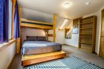The guest bedroom features a twin over queen bunk bed.