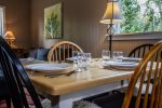 Enjoy a meal with your family at the dining room table- additional seating at the table near the kitchen.