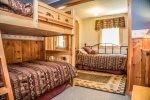 You can enjoy Devil Track Lake views out of the window from the king bed.