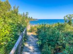 Stroll down to the private shoreline area, accessible by a boardwalk and set of stairs.