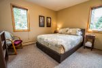 The bedroom features a queen sized bed and attached master bathroom.