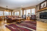 The living room features comfortable leather furniture to sit back and relax and enjoy the Lake Superior views.