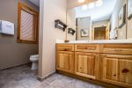 The attached master bathroom has a large vanity sink.