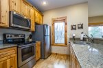 You will love the granite countertops and stainless steel appliances, including a dishwasher.