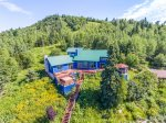 Blue House is a large, private home nestled against Lutsen Mountains ski runs visible behind the house.