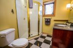 The guest bathroom is located between the game room and third bedroom and has a walk-in shower.