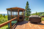 In addition to the private balconies and the lake facing deck there is a 3-season screened in gazebo and gas grill.