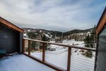 Step out onto the balcony and enjoy the views of Moose Mountain- great all year round at this ski-in/ski-out unit.