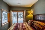 Enjoy great views out of the sliding glass doors in guest bedroom 1.