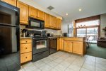 The kitchen is spacious and features granite countertops and new appliances.