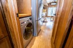 There is a washer/dryer unit in the area between the kitchen and bedroom- great for extended stays.