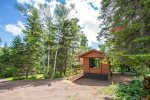 This tiny home sits on a 4-acre wooded lot with no visible neighbors- great privacy