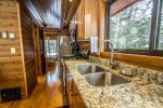 Even though this is a tiny home, the kitchen features full sized appliances, including a gas stove