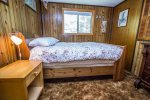 The first bedroom is located off of the kitchen and has a queen bed.
